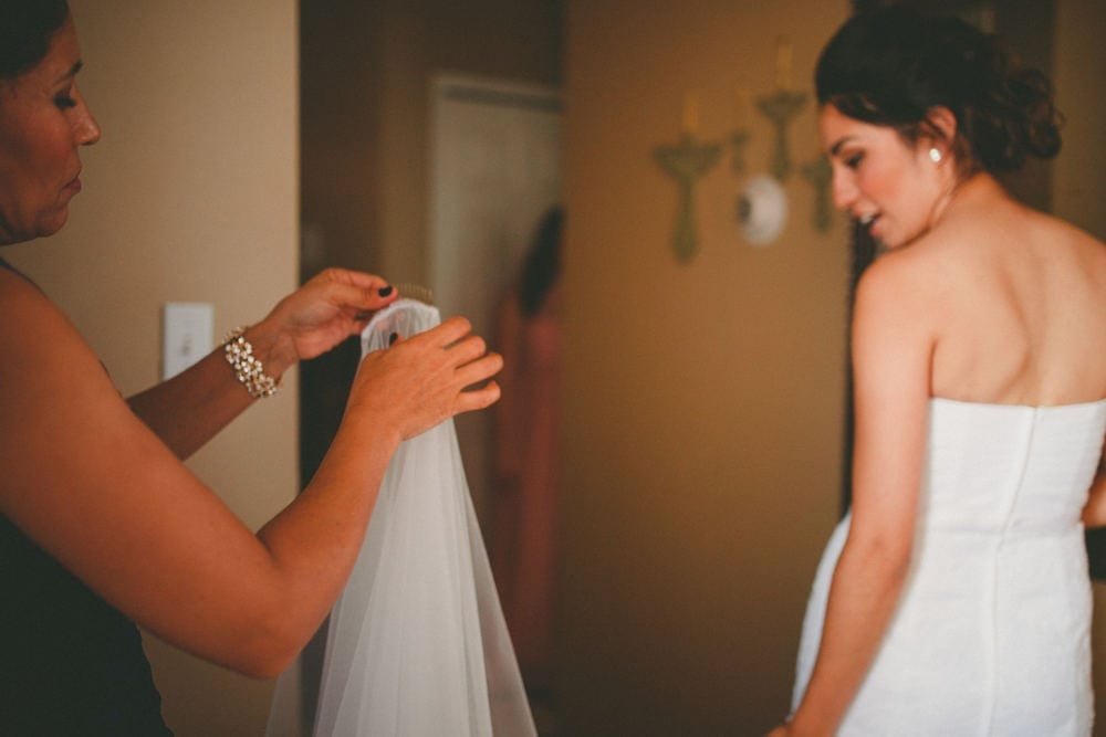 A new Mexico bride's mother bringing her vail to her daughter.