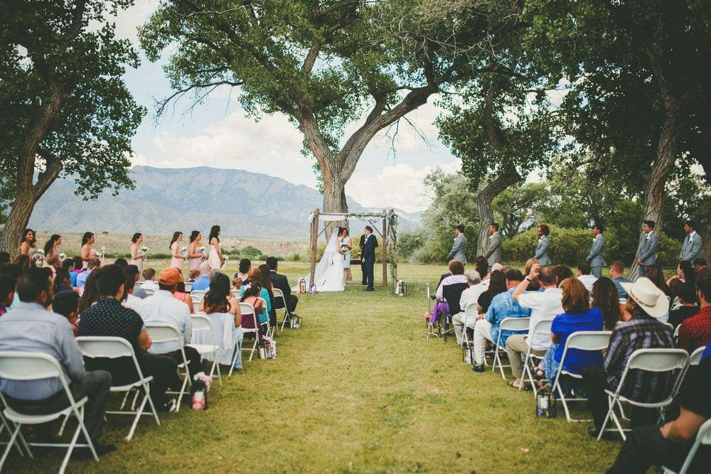 This is a wide angle shot of the wedding at Sandia Lakes Park. The Sandia Mountains can be seen in the background.