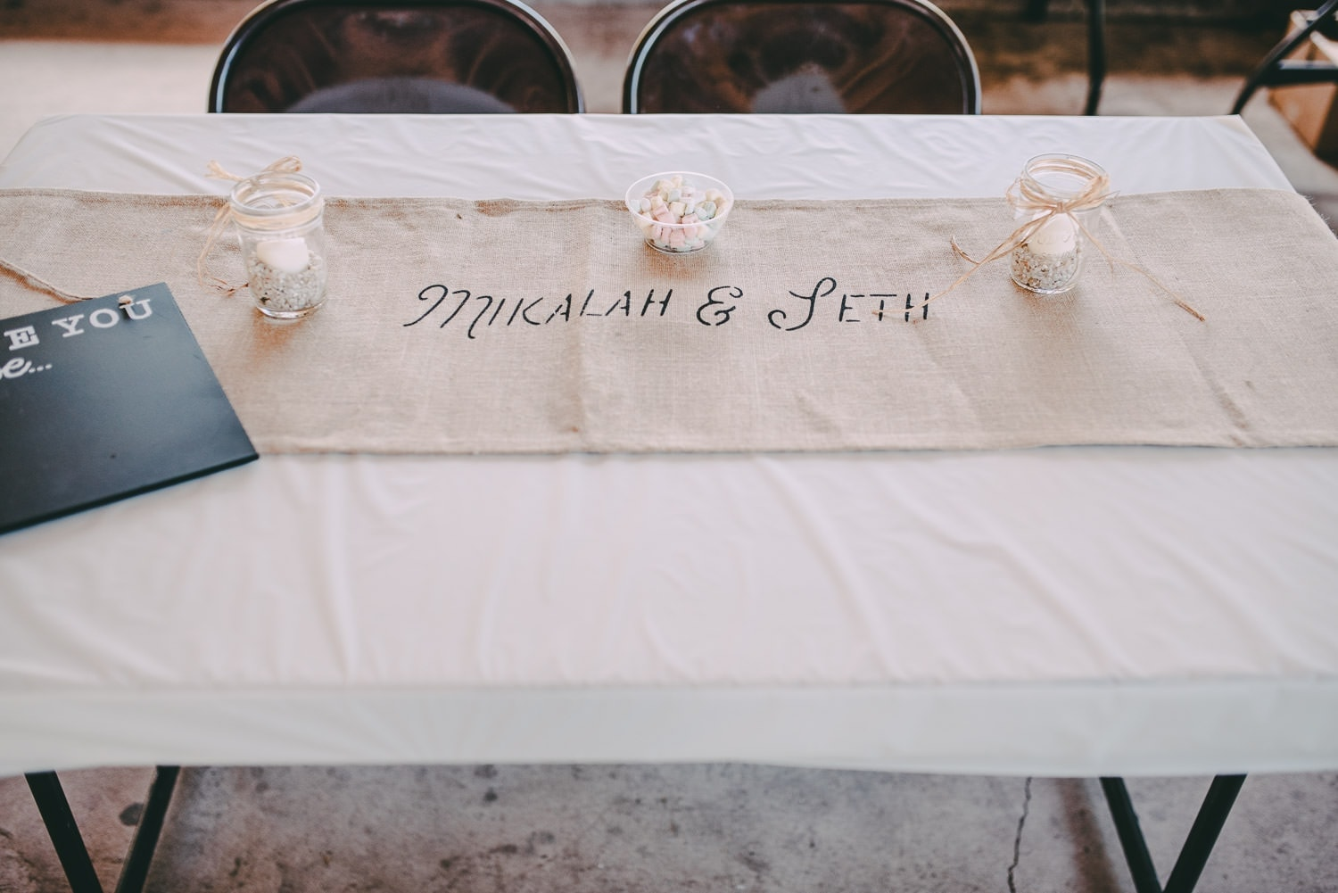 A table runner with the bride and grooms names printed on it