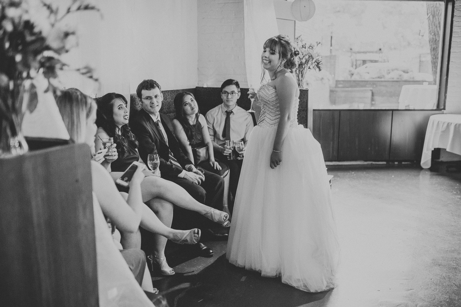 The bride is laughing with her guests.