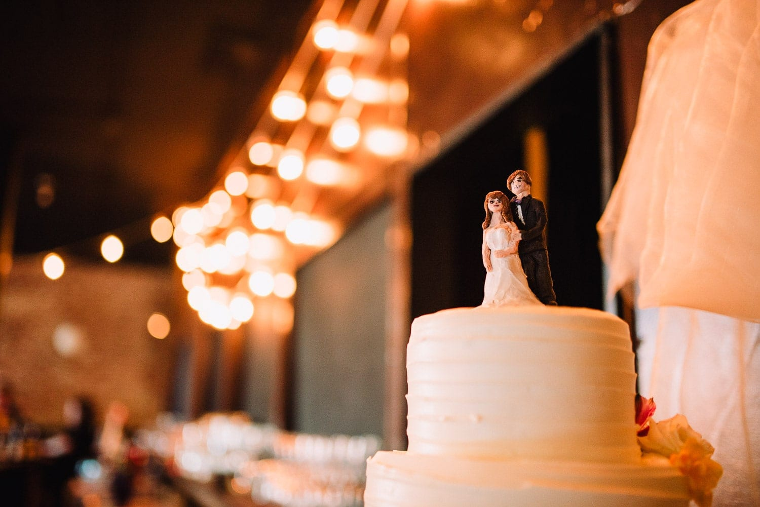 Close view of the wedding cake toppers.