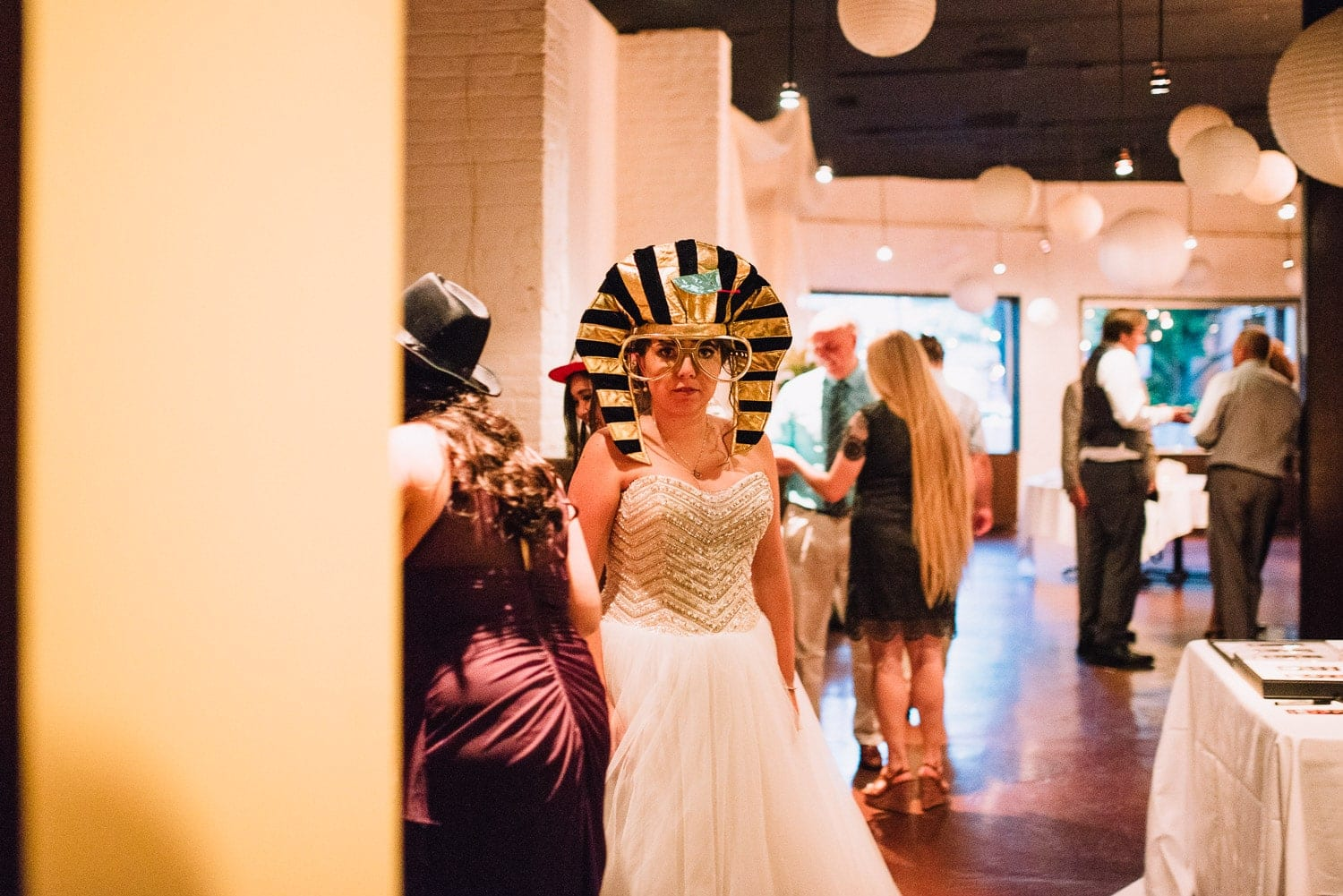 The bride is wearing an Egyptian pharaoh costume for a Photo Booth picture.