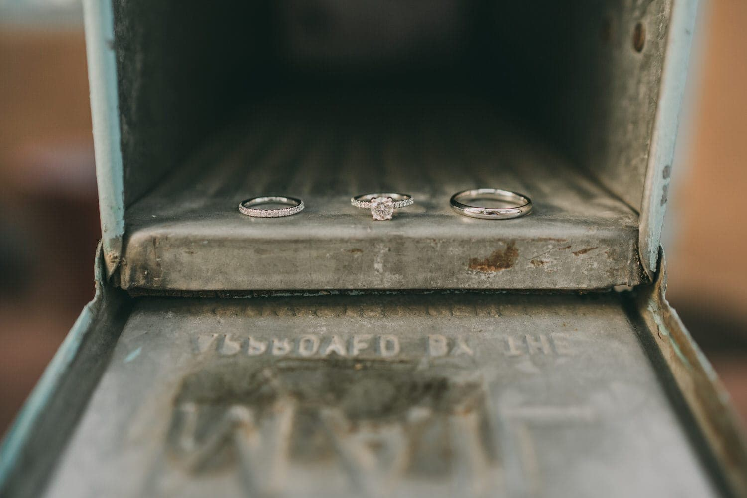 Close up of wedding rings in a mailbox in Santa Fe, New Mexico