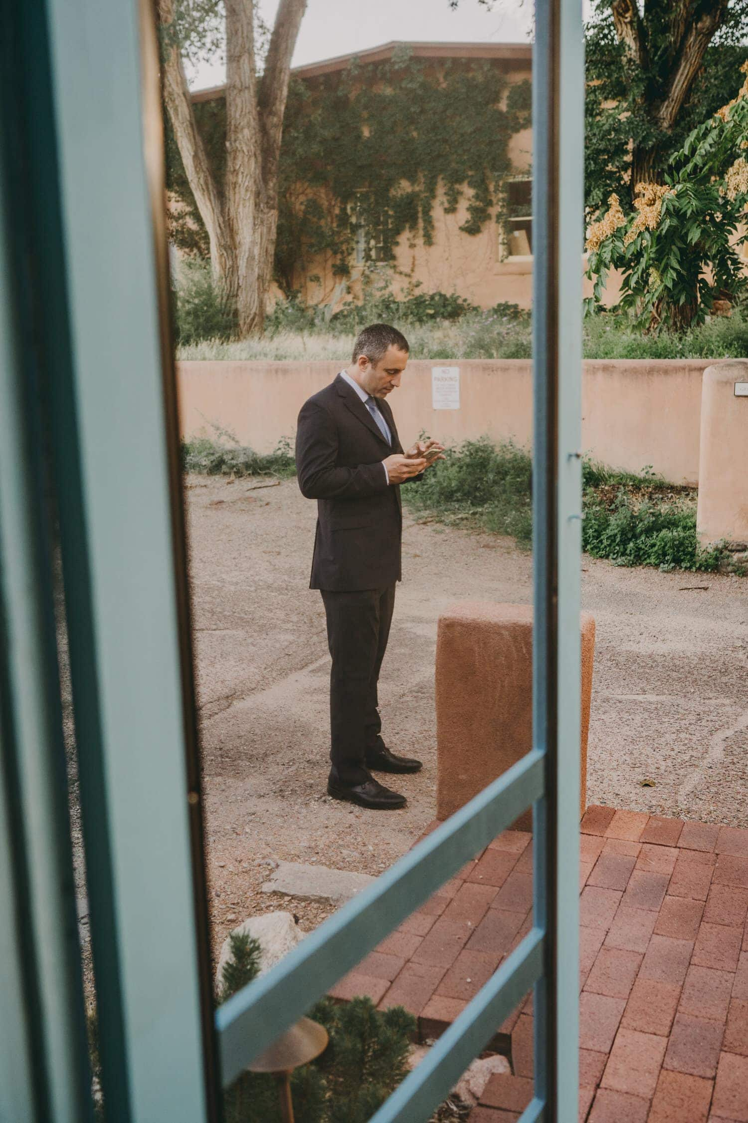 Groom practicing his vows before his elopement ceremony in New Mexico