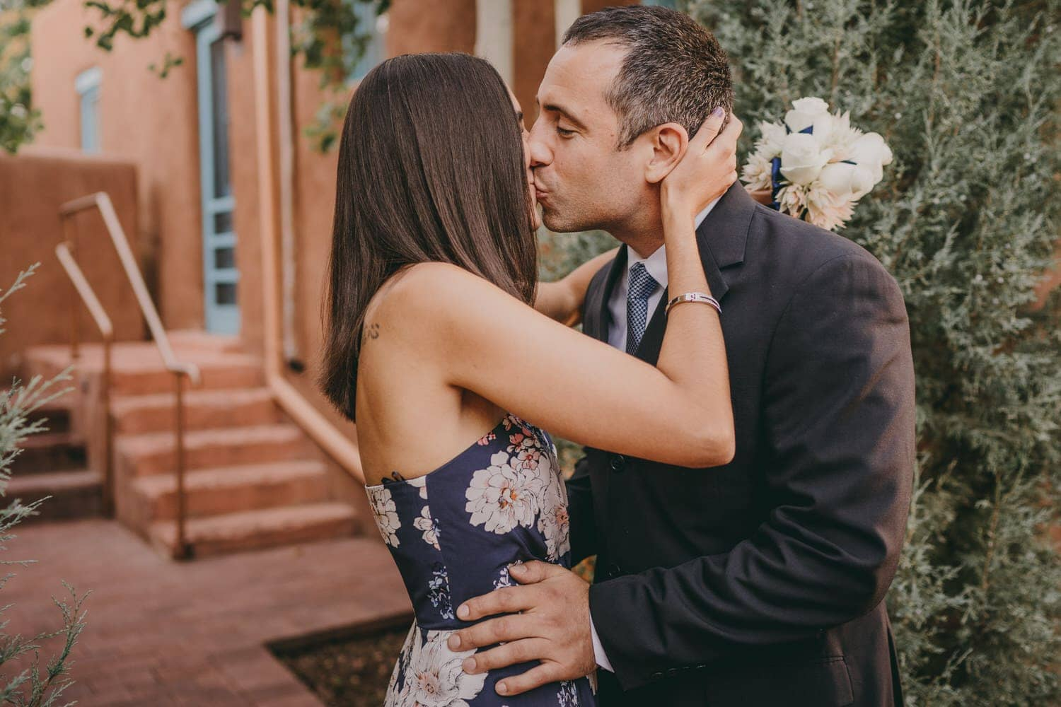 Groom kissing his bride following their first look in Santa Fe