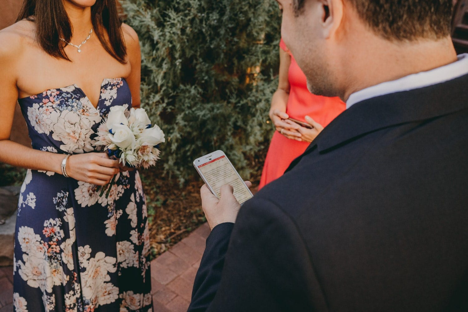 Close up of groom's phone where he has his vows written