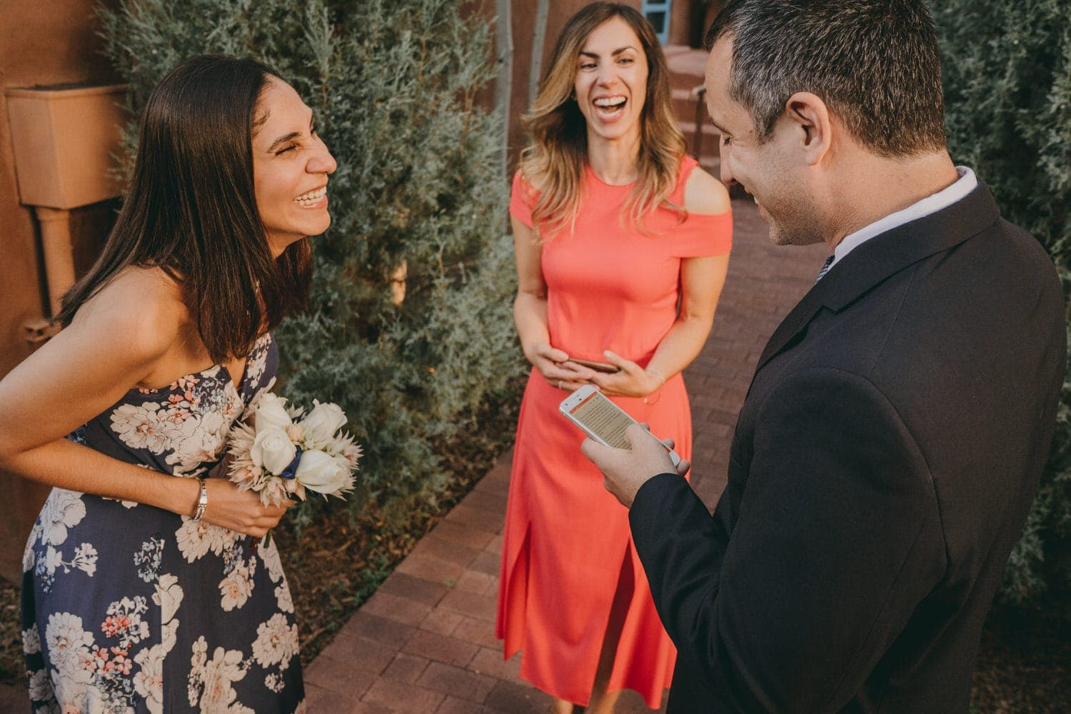 Officiant laughing during the wedding ceremony