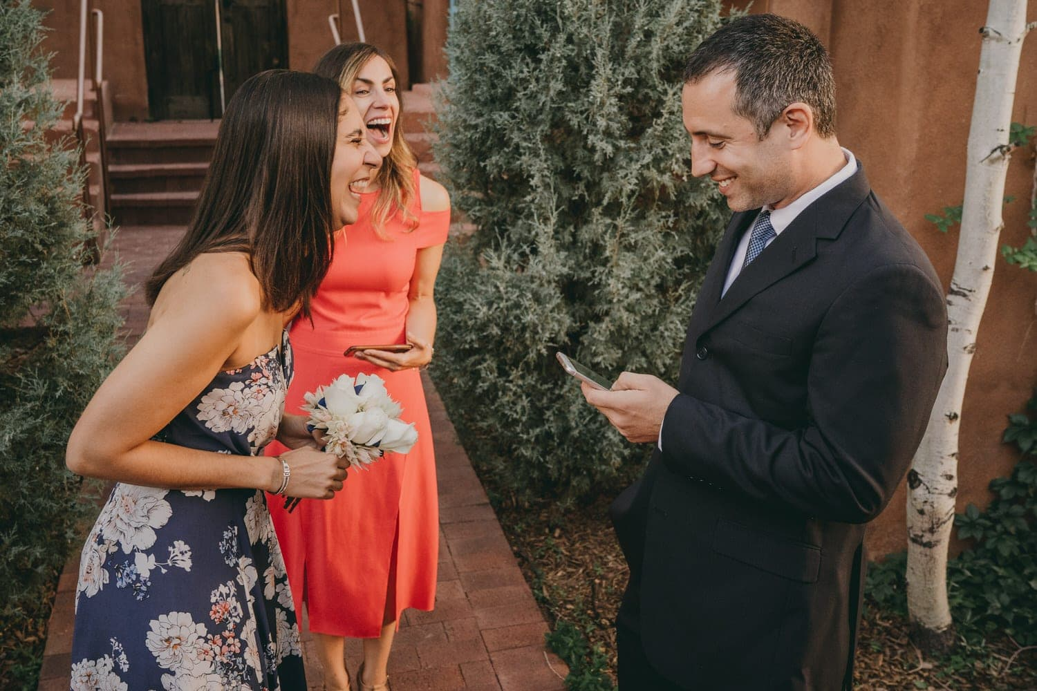 Eloping couple laughing during their ceremony in Santa Fe