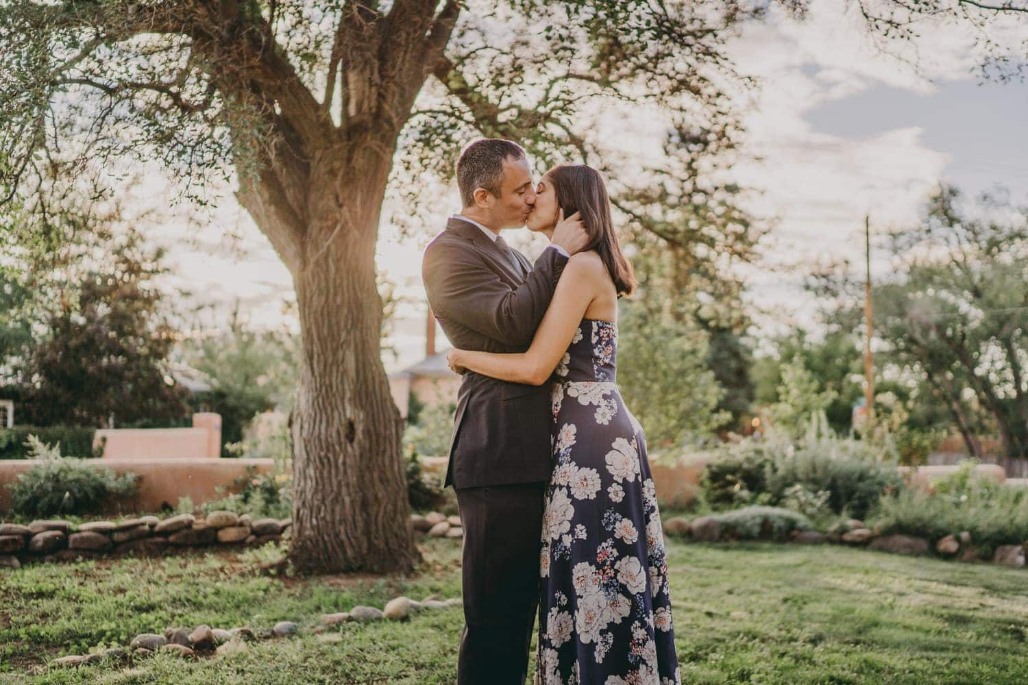 Newlyweds kissing in a garden in Santa Fe, New Mexico