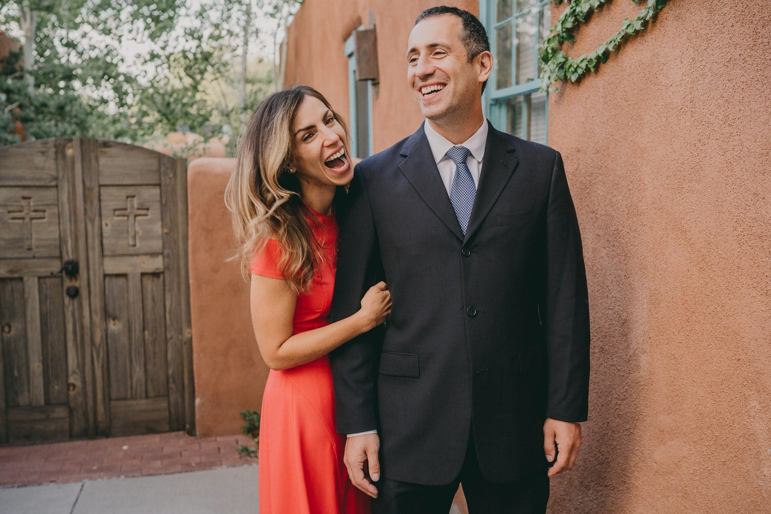 Groom and his sister laughing following their wedding in Santa Fe