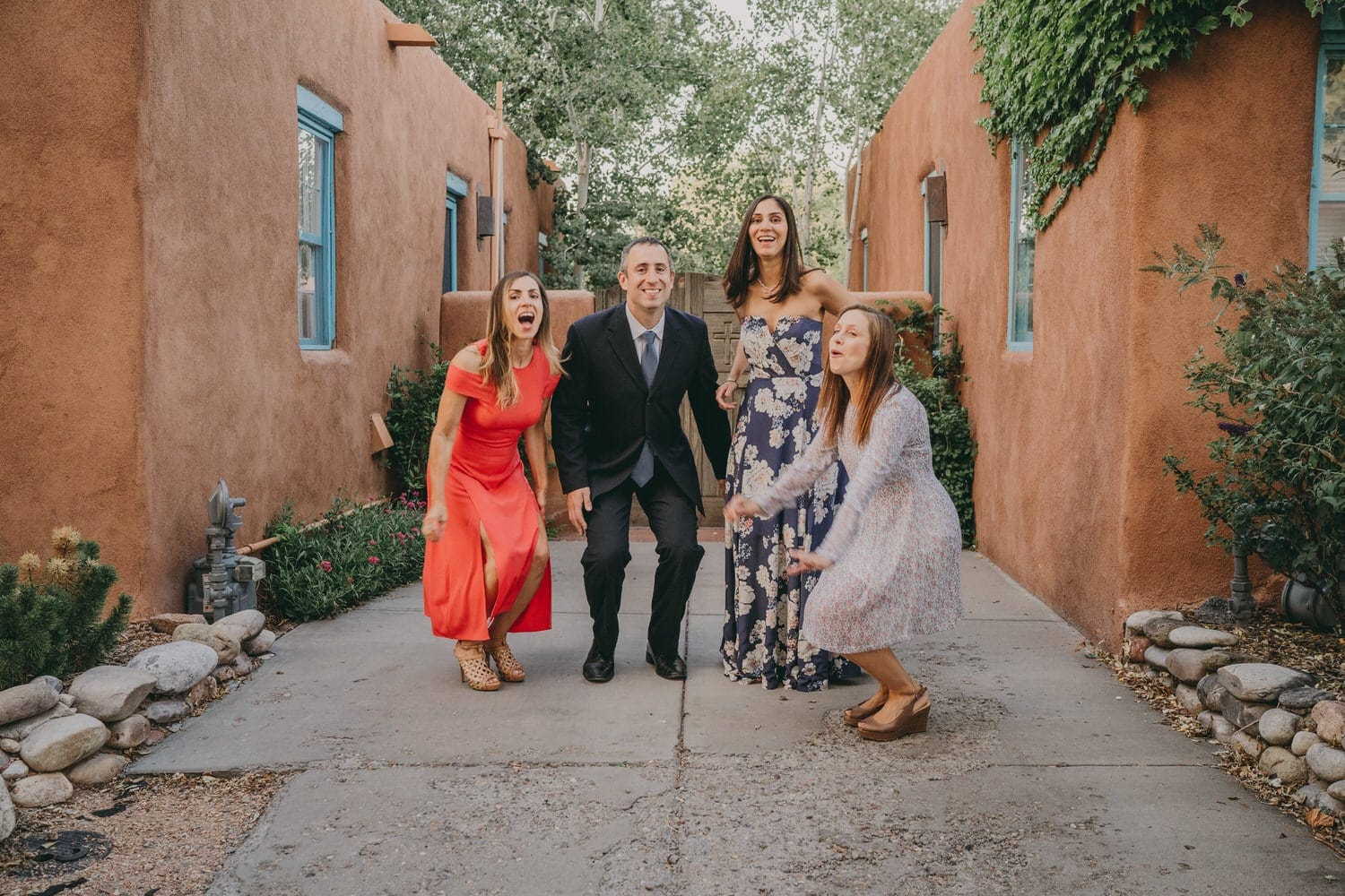 Elopement couple and their friends getting ready to jump