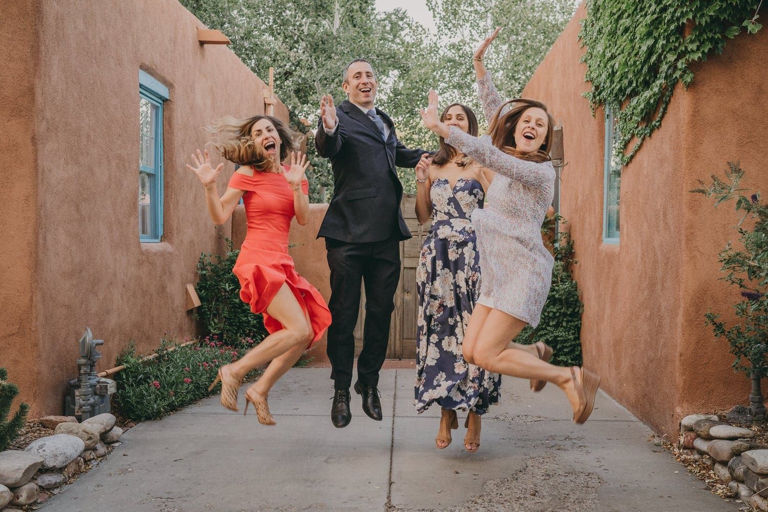 Elopement couple and their friends leaping