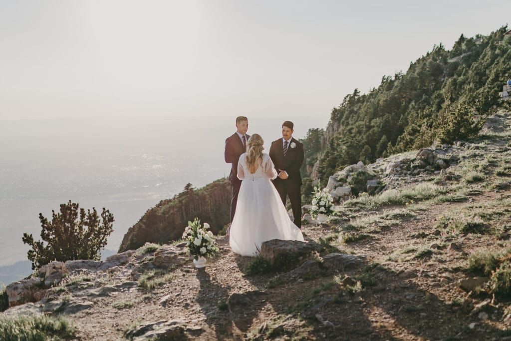 An elopement ceremony is happening at Sandia Crest.