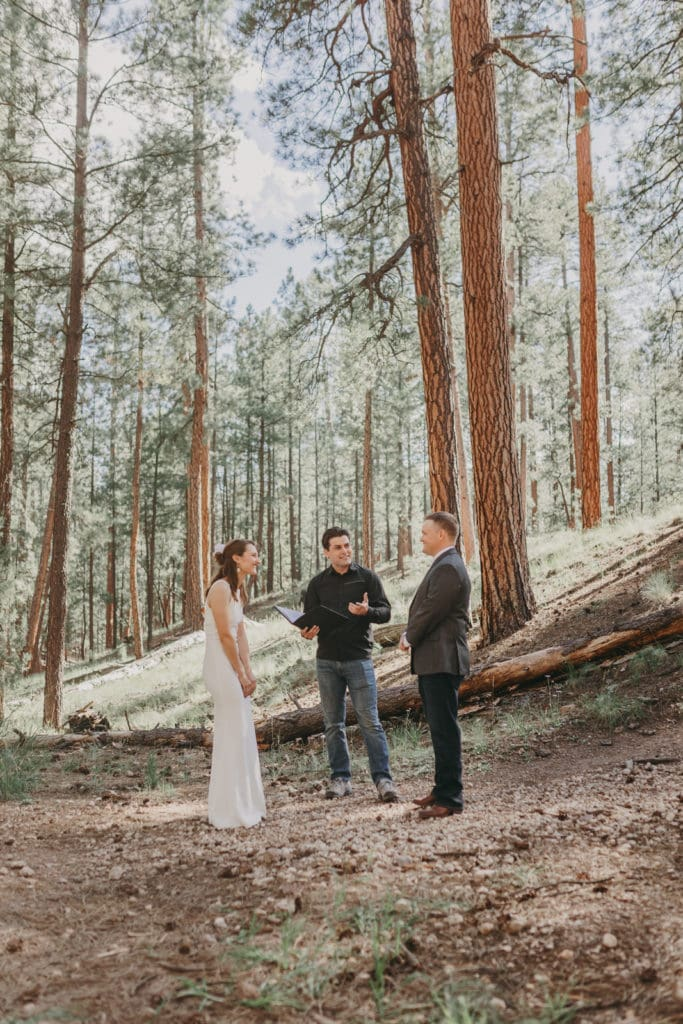 The officiant is conducting the wedding in Jemez.